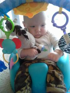 Sitting in his Bumbo and playing with his toys :)